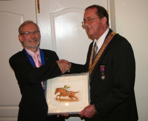 Chairman Paul receiving a gift from National President, Vaughan Harris at the 50th Charter celebration.